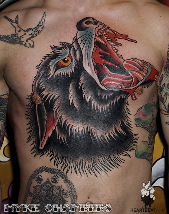 2. wolf head torso traditional tattoo myke chambers